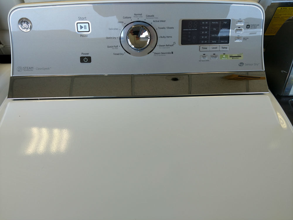 White top load washer dryer