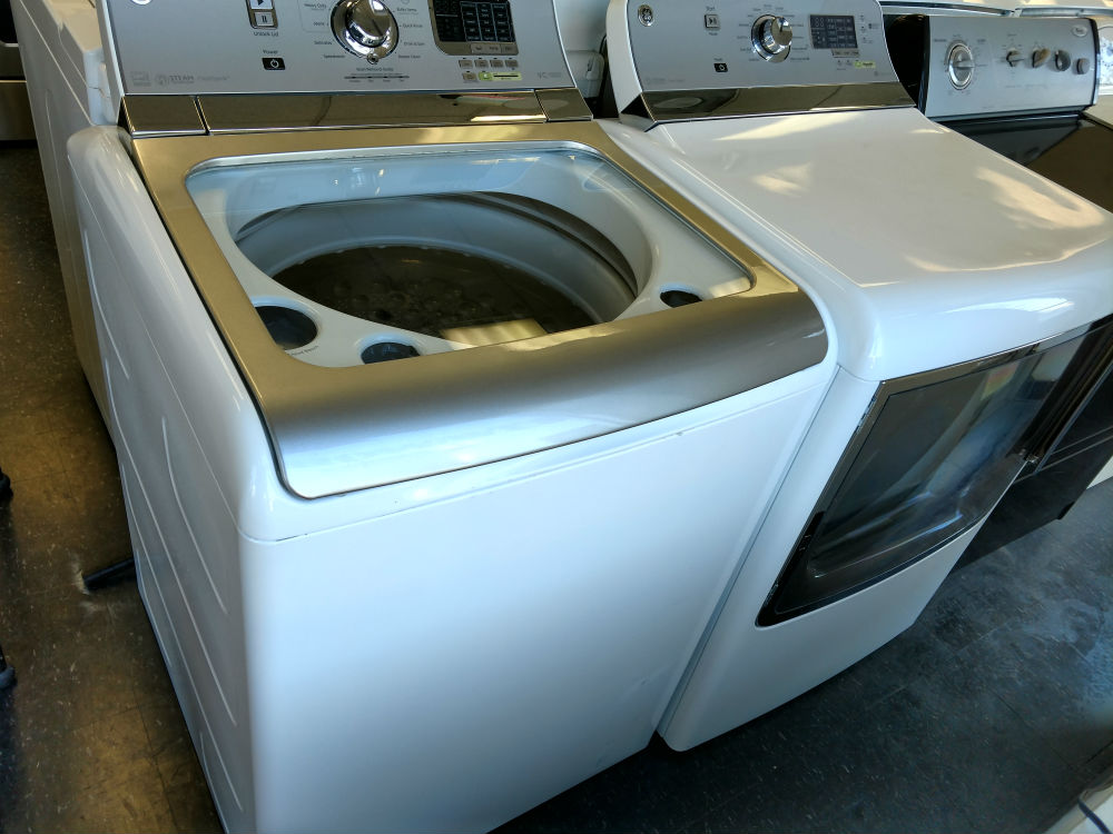 Used white top load washer dryer