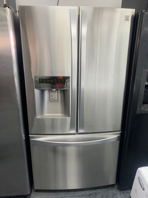 French door refrigerator with water and ice dispenser